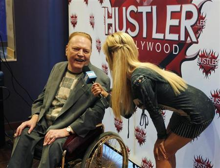 Publisher Larry Flynt, president of Larry Flynt Publications is interviewed at induction ceremonies for adult film stars and producers John Stagliano and actress Belladonna into the Hustler Hollywood Walk of Fame in West Hollywood, California March 22, 2012. REUTERS/Fred Prouser
