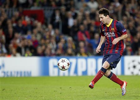 Barcelona's Lionel Messi kicks the ball to score his second goal against AC Milan during their Champions League soccer match at Nou Camp stadium in Barcelona November 6, 2013. REUTERS/Gustau Nacarino