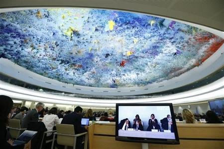 Delegates and representatives listen during the Human Rights Council Universal Periodic Review session at the European headquarters of the United Nations in Geneva October 29, 2013. REUTERS/Denis Balibouse