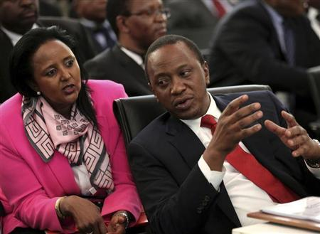 Kenyan President Uhuru Kenyatta (R) chats with his Foreign Minister Amina Mohamed during the two-day meeting of leaders from the Southern African Development Community (SADC) in Pretoria November 4, 2013. REUTERS/Siphiwe Sibeko
