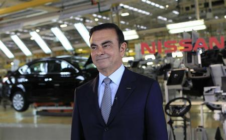 Nissan Chief Executive Carlos Ghosn smiles during an interview with Reuters at the company's new plant in Aguascalientes, Mexico, November 12, 2013. REUTERS/Henry Romero