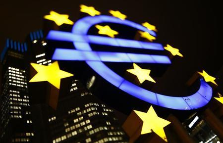 An illuminated euro sign is seen in front of the headquarters of the European Central Bank (ECB) in the late evening in Frankfurt January 8, 2013.REUTERS/Kai Pfaffenbach
