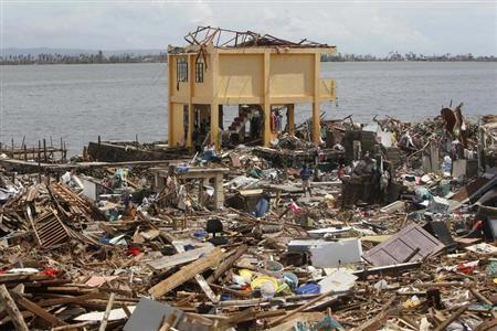 Ruins of houses devastated by Typhoon Haiyan are pictured near a coastal town in Tacloban city, central Philippines November 13, 2013. REUTERS/Romeo Ranoco