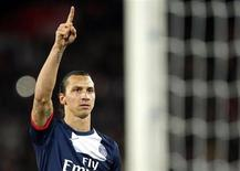 Paris St Germain's Zlatan Ibrahimovic celebrates after scoring against Nice during his French Ligue 1 soccer match at the Parc des Princes Stadium in Paris November 9, 2013. REUTERS/Benoit Tessier