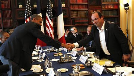 U.S. President Barack Obama (L) shakes hands with French President Francois Hollande during their meeting at the G8 Summit in Enniskillen, Northern Ireland June 18, 2013. REUTERS/Kevin Lamarque