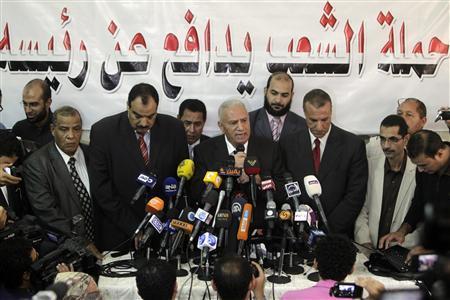 Mohamed Damati, lawyer responsible for deposed Egyptian president Mohamed Mursi's defense, speaks during a news conference in Cairo November 13, 2013. REUTERS/Mohamed Abd El-Ghany