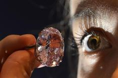 Model Annabeth Murphy-Thomas poses with The Pink Star diamond at Sotheby's auction house in central London in this October 24, 2013 file photo. REUTERS/Toby Melville/Files