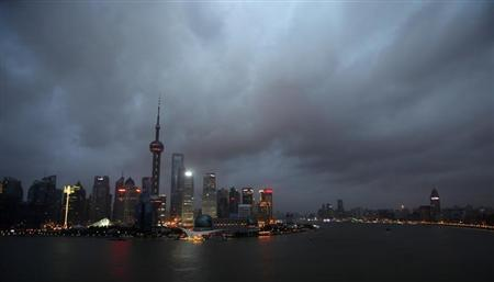 Clouds cover the financial district of Shanghai August 6, 2011, as typhoon Muifa approaches the Chinese province of Zhejiang. REUTERS/Carlos Barria