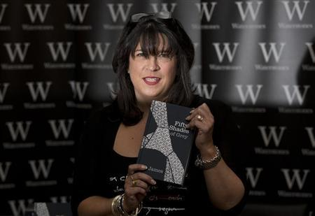 E L James, author of Fifty Shades of Grey, poses for photographers during a book signing in London September 6, 2012. REUTERS/Neil Hall