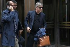 Actor Alec Baldwin (R) departs after testifying in the trial against Genevieve Sabourin at Manhattan Criminal court in New York, November 12, 2013. REUTERS/Lucas Jackson