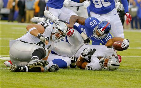 East Rutherford, NJ, USA; Oakland Raiders running back Rashad Jennings (27) picks up first down against the New York Giants during the first half at MetLife Stadium. Mandatory Credit: Jim O'Connor-USA TODAY Sports