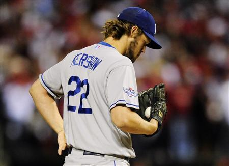 St. Louis, MO, USA; Los Angeles Dodgers starting pitcher Clayton Kershaw reacts during the third inning against the St. Louis Cardinals in game six of the National League Championship Series baseball game at Busch Stadium. Mandatory Credit: Jeff Curry-USA TODAY Sports