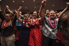 Deborah Cohn (L-R), Carolyn Golujuch, Michele Golujuch and Danny Robinson celebrate after Hawaii Governor Neil Abercrombie signed Senate Bill 1, allowing same sex marriage to be legal in the state, in Honolulu, Hawaii November 13, 2013. REUTERS/Hugh Gentry