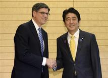 U.S. Treasury Secretary Jack Lew (L) shakes hands with Japan's Prime Minister Shinzo Abe at the start of their meeting at Abe's official residence in Tokyo November 12, 2013. REUTERS/Toshifumi Kitamura/Pool