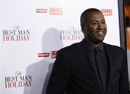 Director of the movie Malcolm D. Lee poses at the premiere of ''The Best Man Holiday'' in Hollywood, California November 5, 2013. The movie opens in the U.S. on November 15. REUTERS/Mario Anzuoni