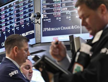 Traders work at the post that trades JP Morgan on the floor of the New York Stock Exchange May 11, 2012. REUTERS/Brendan McDermid