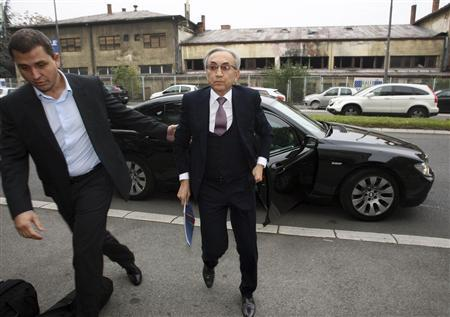Miroslav Miskovic (C), Serbian billionaire retail tycoon, arrives at the Special Court in Belgrade, November 14, 2013. REUTERS/Djordje Kojadinovic