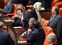 Turkey's ruling AK Party (AKP) lawmakers Nurcan Dalbudak (standing C) and Sevde Beyazit Kacar attend the general assembly wearing their headscarves at the Turkish Parliament in Ankara October 31, 2013. REUTERS/Umit Bektas