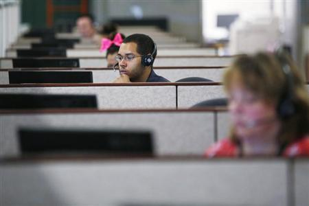 Specialists help callers and potential customers find health insurance at a customer contact and call center for HealthSource RI, Rhode Island's health insurance exchange program for the Affordable Care Act or ''ObamaCare,'' in Providence, Rhode Island October 25, 2013. REUTERS/Brian Snyder