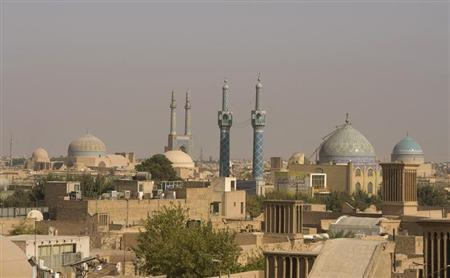 Mosques are pictured in the skyline of Yazd, 700 km (435 miles) south of Tehran, October 15, 2008. REUTERS/Caren Firouz