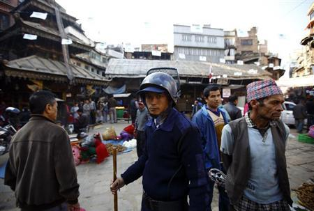 A temporary police personnel, recruited for the constituent assembly elections scheduled for November 19, patrols around the market in Kathmandu November 12, 2013. REUTERS/Navesh Chitrakar