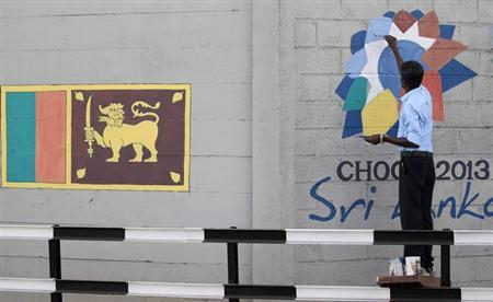 A man paints the logo of CHOGM 2013, ahead of the upcoming Commonwealth Heads of Government Meeting (CHOGM) 2013, in Colombo, November 11, 2013. REUTERS/ Dinuka Liyanawatte