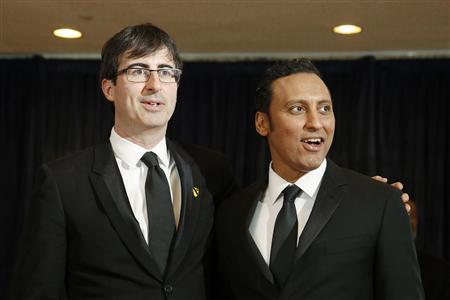 Comedians John Oliver (L) and Aasif Mandvi arrive on the red carpet at the annual White House Correspondents' Association dinner in Washington in this April 27, 2013, file photo. REUTERS/Jonathan Ernst/Files