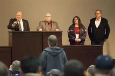 (L-R) Union leaders Mark Johnson, Tom Wroblewski, Susan Palmer and Rich Michalski announce the results of a union vote while speaking at the International Association of Machinists District 751 Headquarters in Seattle, Washington November 13, 2013. REUTERS/David Ryder