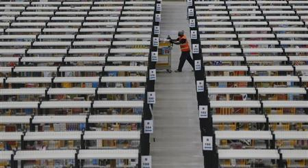 A worker collects orders at Amazon