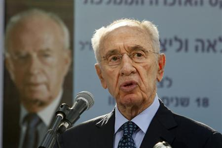 Israeli President Shimon Peres gives a speech during a ceremony for late Israeli prime minister Yitzhak Rabin at the Mount Herzl cemetery in Jerusalem October 16, 2013, marking 18 years since Rabin was assassinated at a peace rally. REUTERS/Gali Tibbon/Pool