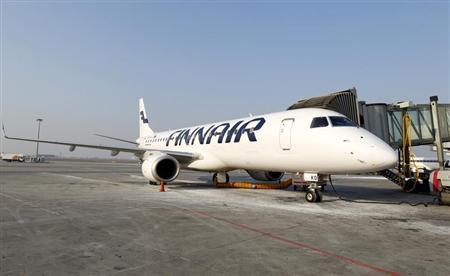 A Finnair airplane is docked at the Chopin International Airport in Warsaw February 6, 2012. Finnair will present its Quarterly results on February 9, 2012. REUTERS/Peter Andrews
