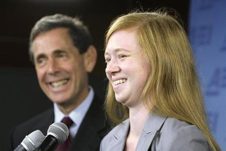 Abigail Fisher (R), a white suburban Houston student who asserted she was wrongly rejected by the University of Texas at Austin while minority students with similar grades and test scores were admitted thanks to the admissions policy, and Edward Blum (L), director of the Project on Fair Representation, smile at a news conference in Washington, June 24, 2013. REUTERS/Jonathan Ernst