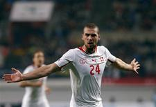 Switzerland's Pajtim Kasami (C) celebrates after scoring a goal against South Korea during their friendly soccer match at the Seoul World Cup stadium in Seoul November 15, 2013. REUTERS/Kim Hong-Ji