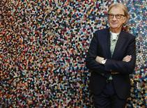 "Fashion designer Paul Smith poses after an interview with Reuters at the media launch of the exhibition ""Hello, My Name is Paul Smith"", at the Design Museum in London November 14, 2013. REUTERS/Luke MacGregor"