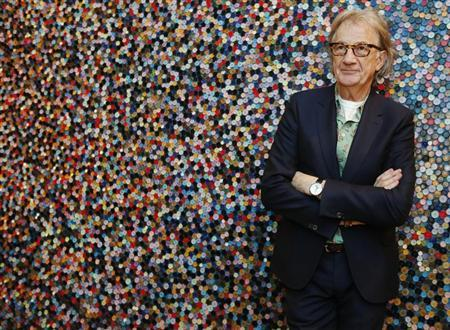 Fashion designer Paul Smith poses after an interview with Reuters at the media launch of the exhibition ''Hello, My Name is Paul Smith'', at the Design Museum in London November 14, 2013. REUTERS/Luke MacGregor