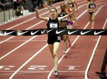 Mary Cain, 16, celebrates as she wins the women's 1 mile run finals at the USA Indoor Track and Field Championships in Albuquerque, New Mexico March 3, 2013. REUTERS/Eric Draper
