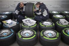 Red Bull Formula One team members check tires at the Circuit of the Americas in Austin, Texas November 14, 2013. The U.S. Grand Prix will take place on Sunday. REUTERS/Adrees Latif