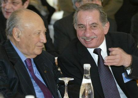 Greek Cypriot President Tassos Papadopoulos (R) talks to the former Greek Cypriot President Glafcos Clerides (L) before a meeting of the delegations in Buergenstock, Switzerland, March 29, 2004. REUTERS/POOL/Attila Kisbenedek