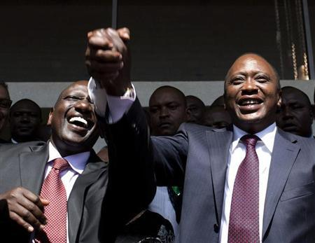President-elect Uhuru Kenyatta (R) greets his supporters with his running mate, former cabinet minister William Ruto after attending a news conference in Nairobi March 9, 2013. REUTERS/Siegfried Modola