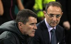 Ireland's manager Martin O'Neill (R) looks on at his coach Roy Keane (L) during their international friendly soccer match against Latvia at the Aviva Stadium in Dublin November 15 , 2013. REUTERS/Cathal McNaughton