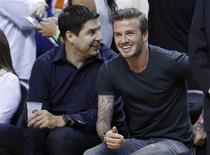 Soccer player David Beckham sits before Game 5 of the NBA Eastern Conference final basketball playoff between the Indiana Pacers and the Miami Heat in Miami, Florida May 30, 2013. REUTERS/Joe Skipper