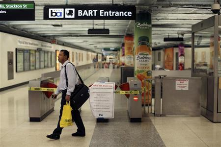 A man turns away at the Powell Street station after learning of a strike by employees of the Bay Area Rapid Transit (BART) in San Francisco, California October 21, 2013. REUTERS/Robert Galbraith