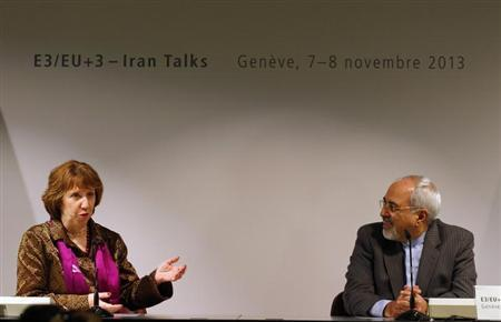 Iranian Foreign Minister Mohammad Javad Zarif (R) listens to European Union foreign policy chief Catherine Ashton during a news conference after nuclear talks at the United Nations European headquarters in Geneva November 10, 2013. REUTERS/Denis Balibouse