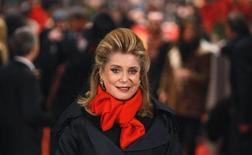 "Actress Catherine Deneuve poses on the red carpet for the screening of the movie ""Elle s'en va"" (On My Way) at the 63rd Berlinale International Film Festival in Berlin February 15, 2013. REUTERS/Tobias Schwarz"