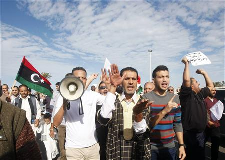 Protesters march during a demonstration calling on militiamen to leave, in Tripoli November 15, 2013. REUTERS/Ismail Zitouny