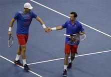 Czech Republic's Tomas Berdych (L) and Radek Stepanek celebrate a point against Serbia's Nenad Zimonjic and Ilija Bozoljac during their Davis Cup World Group final doubles tennis match in Belgrade November 16, 2013. REUTERS/Stoyan Nenov