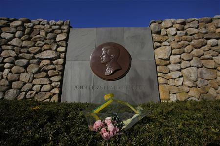 Flowers are left at the memorial for U.S. President John F. Kennedy in Hyannis, Massachusetts November 14, 2013. November 22 will mark the 50th anniversary of his assassination in 1963. REUTERS/Brian Snyder