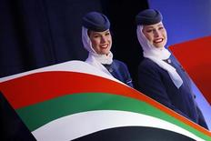 Etihad Airways stewardess smile after signing a strategic partnership deal in Belgrade August 1, 2013. REUTERS/Marko Djurica