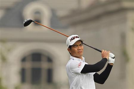 Liang Wenchong of China plays a shot on the first hole during the BMW Masters 2012 golf tournament at Lake Malaren Golf Club in Shanghai, October 26, 2012. REUTERS/Aly Song