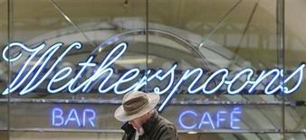 A Wetherspoon's logo is seen at a bar in central London March 13, 2009. Pubs group JD Wetherspoon posted better-than-expected interim results on Friday and said it continues to trade well, pushing the shares up as much as 16 percent. REUTERS/Toby Melville